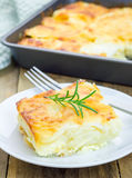 Potato gratin. On a white plate royalty free stock photo
