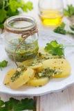 Potato with green salsa. Potato salad with fresh green salsa Stock Image