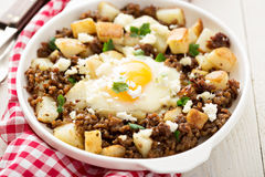 Potato hash with sausage and fried egg Royalty Free Stock Photography