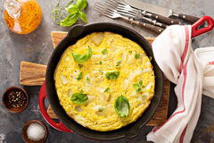 Potato and herbs fritatta. In a cast iron pan royalty free stock photography