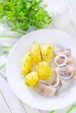 Potato and herring Stock Image