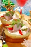 Potato with herrings and sour cream stock photo