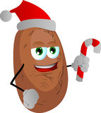Potato holding a candy cane and wearing Santa's hat Stock Photo