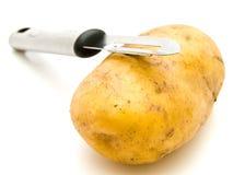 Potato with knife Stock Photo