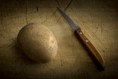 Potato and knife Stock Photo
