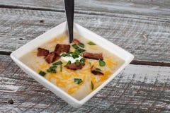 Potato Leek Soup on barn table Stock Images