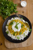 Potato and lentil curry. Indian lentil curry with diced potatoes and rice on a plate Stock Photo