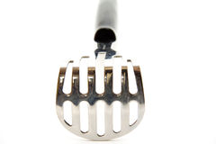 Potato masher. Of metal and plastic royalty free stock image