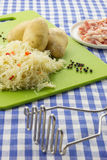 Potato masher and ingredients for typical dutch dish zuurkool Stock Photo