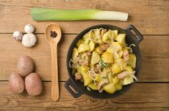 Potato with meat in a black cast iron pot Stock Image