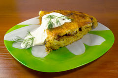 Potato and meat pie. Piece of potato and meat pie on a plate Royalty Free Stock Images