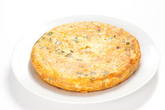 Potato omelette with olive oil and green pepper Stock Photos