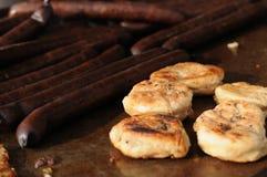 Potato pamkakes with sausages Stock Photos