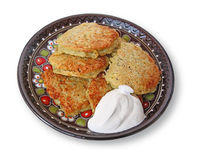 Potato pancake. National Ukrainian meal potato pancake of Deruny or Draniki on a dish with sour cream royalty free stock image