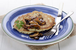Potato pancake on a blue plate Royalty Free Stock Image