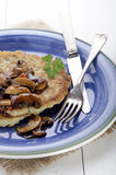 Potato pancake on a blue plate Royalty Free Stock Photography