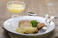 Potato pancake with bramley apple sauce Stock Images