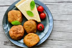 Home made   potatoes Croquette. Potato pancake or croquette  , parmesan cheese and cherry tomatoes Stock Images