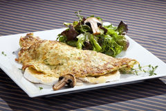 Potato pancake filled by camembert and mushrooms Stock Photo