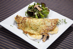 Potato pancake filled by camembert and mushrooms Royalty Free Stock Images