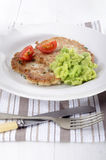 Potato pancake with mushy pea. Tomato and thyme on a with plate Royalty Free Stock Image