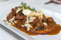 Potato pancake with Polish style beef stew stock photo