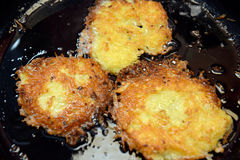 Potato pancake. Is roast in a iron pan royalty free stock photography