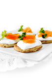 Potato Pancake And Smoked Salmon Canapes. Against a white background. Copy space Royalty Free Stock Photography