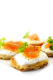 Potato Pancake And Smoked Salmon Canapes. Against a white background. Copy space Royalty Free Stock Images