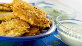 Potato pancake with sour cream. And garlic dips Royalty Free Stock Photos