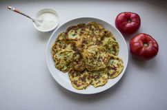Potato Pancake with Sour Cream and Tomatoes Stock Photos