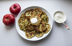 Potato Pancake with Sour Cream and Tomatoes Royalty Free Stock Photos