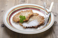 Potato pancake with sugar on a plate Stock Images