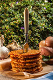 Potato pancake on a wooden table. Royalty Free Stock Image