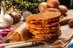 Potato pancake on a wooden table. Stock Images