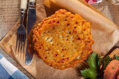 Potato pancake on a wooden table. Stock Photos