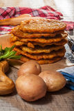 Potato pancake on a wooden table. Royalty Free Stock Images