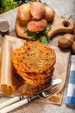 Potato pancake on a wooden table. Royalty Free Stock Photo