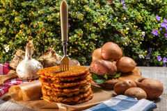 Potato pancake on a wooden table. Royalty Free Stock Photography