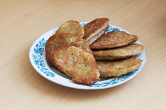 Potato pancakes. Fritters or pancakes of potatoes in a plate with a pattern Royalty Free Stock Photo