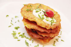 Potato pancakes. Pile of potato pancakes with the sour cream Stock Photos