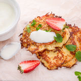Potato pancakes with apfel and strawberry Royalty Free Stock Photo