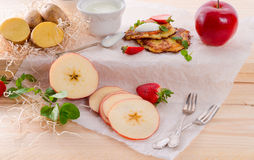 Potato pancakes with apfel and strawberry stock image