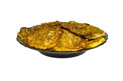 Potato pancakes on a black plate, isolated. Grated fried potatoes. royalty free stock images