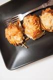 Potato pancakes on black plate Royalty Free Stock Photos