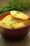 Potato pancakes in brown bowl Royalty Free Stock Image