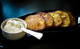 Potato pancakes with cream homemade Stock Photos