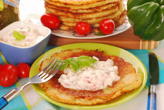Potato pancakes with creamy cheese Royalty Free Stock Photography