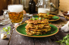 Potato pancakes with garlic and beer stock photo