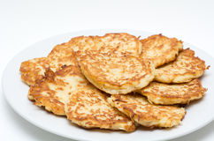 Potato Pancakes for Hanukkah Jewish Holiday. Traditional Hanukkah Potato Pancakes - Latkes - Levivot on a white plate during the Jewish Festival of Lights
